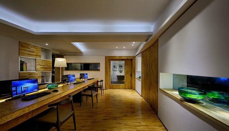 现代简约办公室装修员工办公区在一个墙面分隔出长